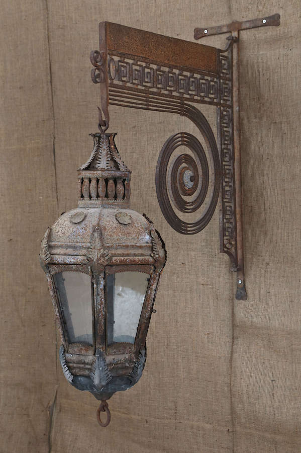 18th century French Tole lantern on a wrought iron wall bracket