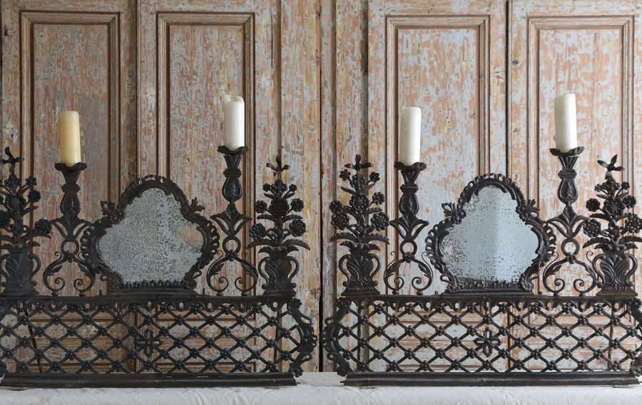 Pair of 17th century Portuguese repousse altar mirrors