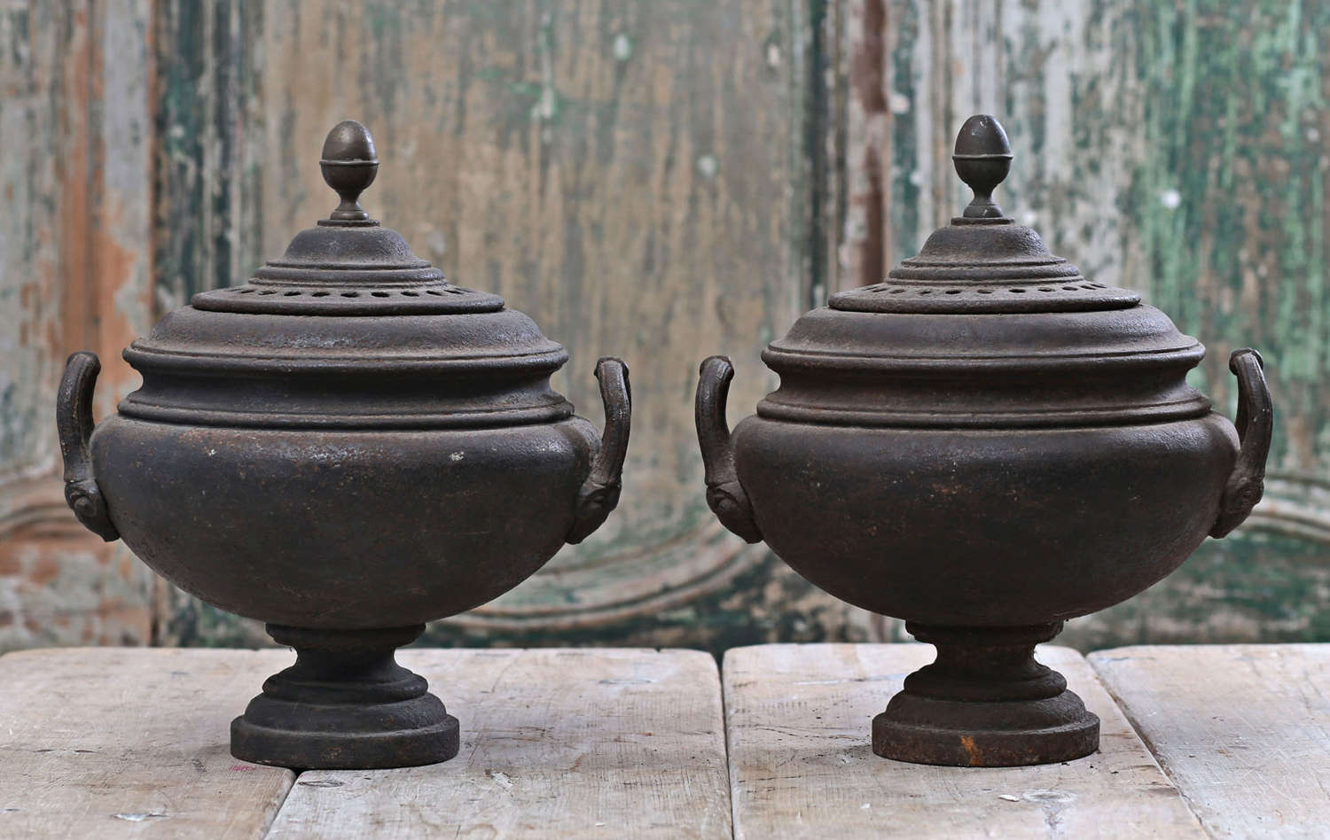 Pair of English Regency cast iron incense burners