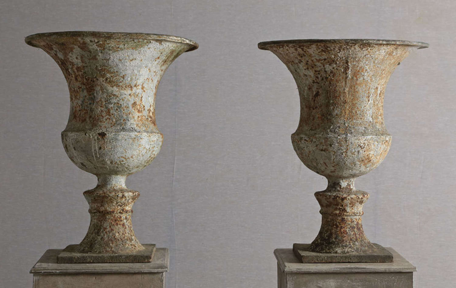 Pair of 18th century English cast iron urns