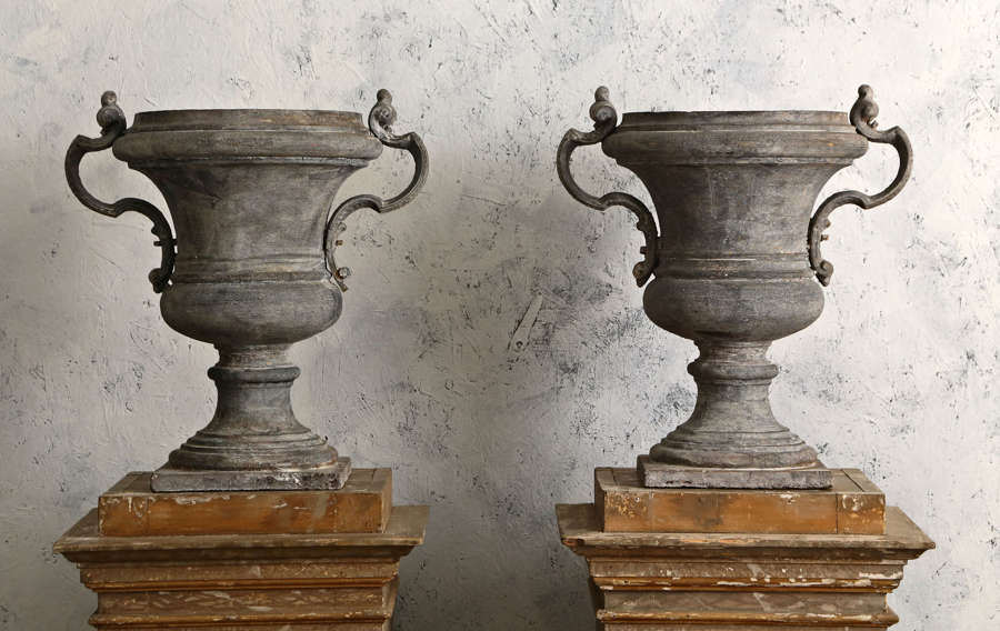 Pair of 18th century French cast iron urns