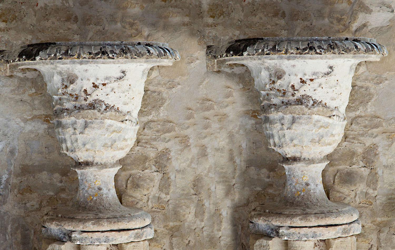 Pair of 18th century French Regence stone urns