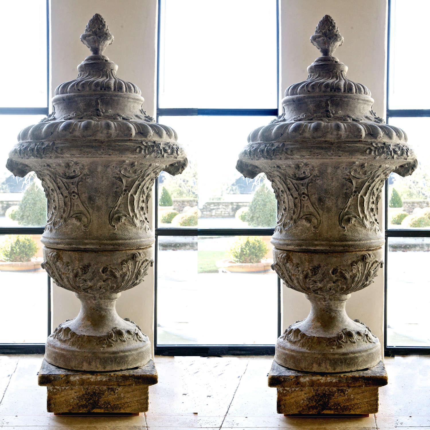 Pair of 18th century Louis XIV cast iron Urns